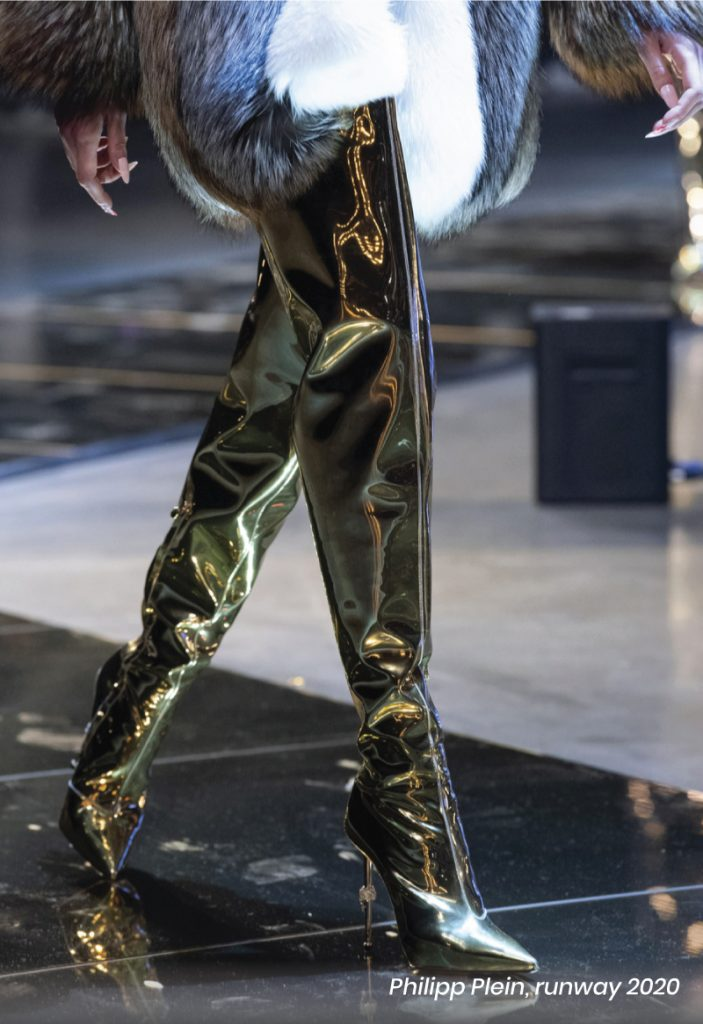 Fall Heel Trends From The Runway To Your Feet. Philipp Plein, runway of 2020, with edgy gold over-the-knee boots.
