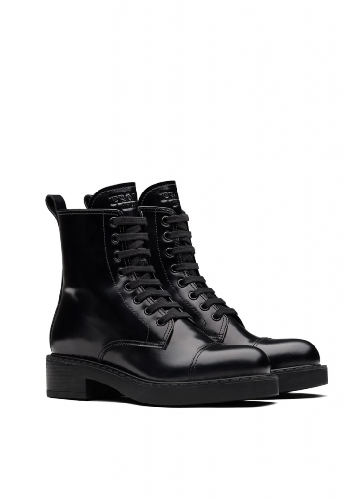 The Boots That Will Fit Perfectly With Your Autumn Jeans. Prada Block Heel Combat Boots.