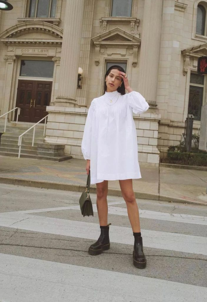 The Outfit You Will Want To Wear All Winter Long - Dress and Boots. A great short white dress and chunky black boots.