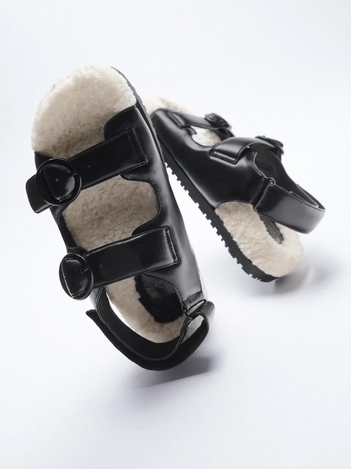 Out With The Slippers, In With This Spring Shoe Trend: faux fur flat sandals from Zara.