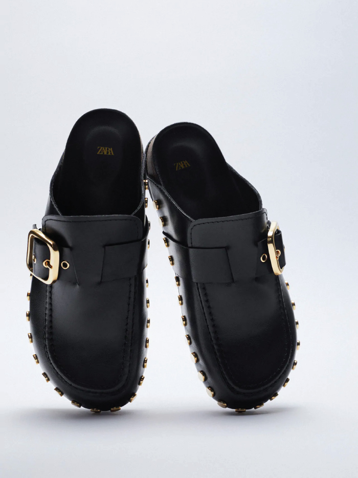 Why Zara Has The Best Shoe Collection For Spring: Flat Leather Clogs With Studs And Buckle from Zara.