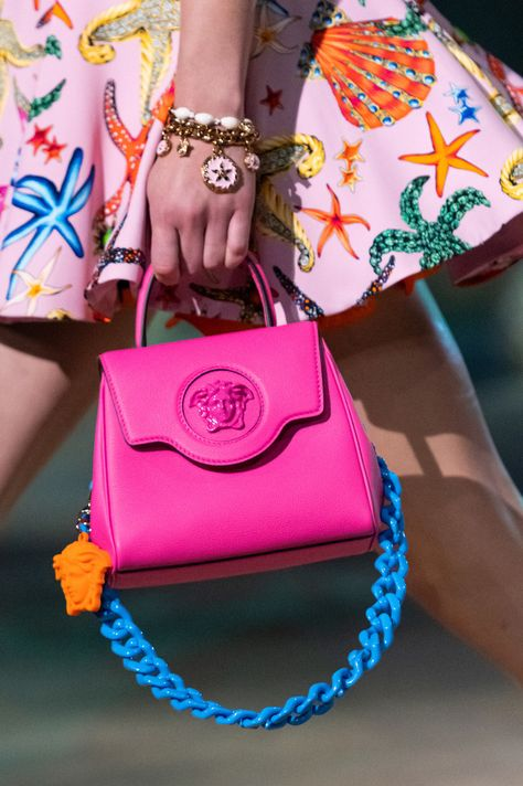 PINK MINI HANDBAG WITH A BLUE CHAIN AND ORANGE DETAILS  from VERSACE