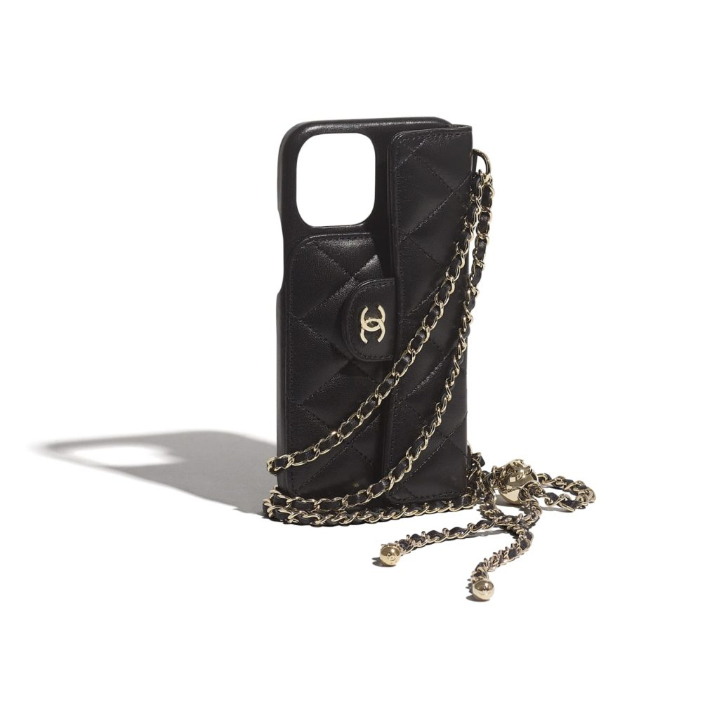 BLACK PHONE CASE WITH GOLD CHAIN from CHANEL
