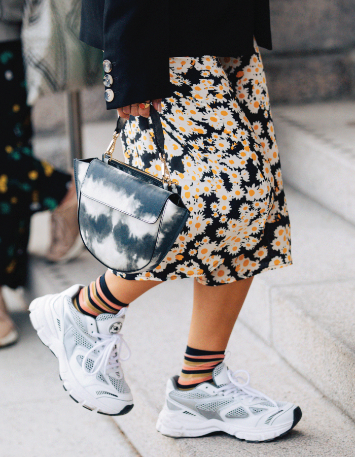 The Shoe Trends That Will Take Over This Fall. Sneakers with midi skirt.