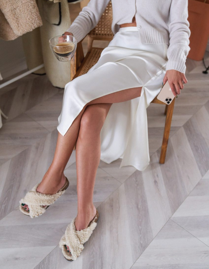The Shoe Trends That Will Take Over This Fall. Beige slippers and silk skirt.