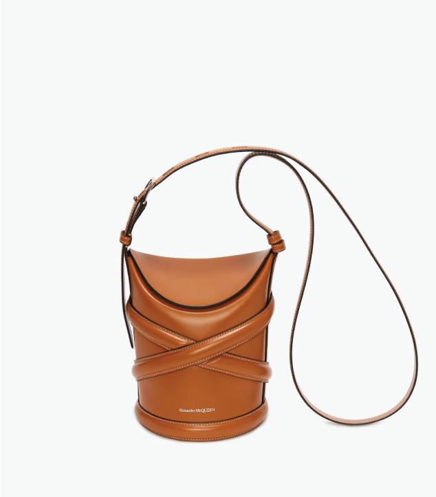 The Designer Bags Of 2021. Alexander McQueen The Curve Bag in Tan