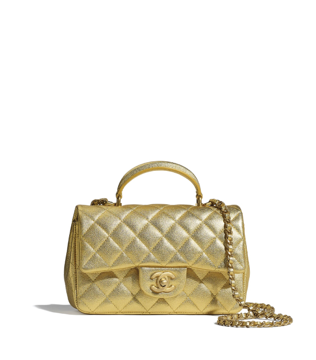 The Designer Bags Of 2021. Chanel Mini Flap Bag With Top Handle Gold