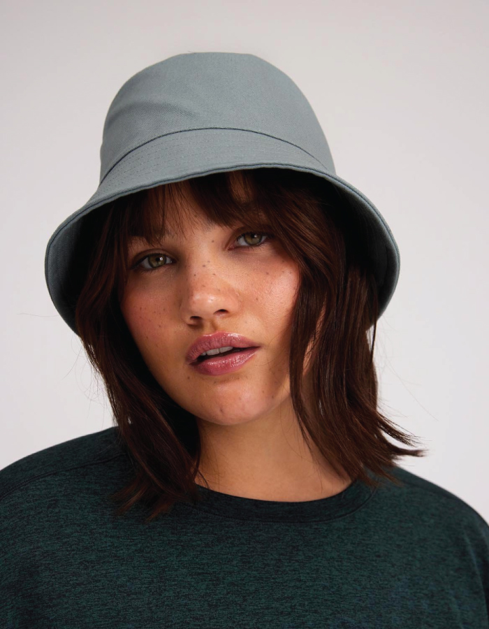 Bucket Hats You Will Want To Wear All Summer. Grey bucket hat from sustainable brand Girlfriend Collective.