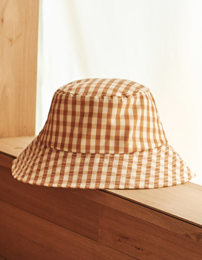 Bucket Hats You Will Want To Wear All Summer. Beige check hat from Loeffler Randall.